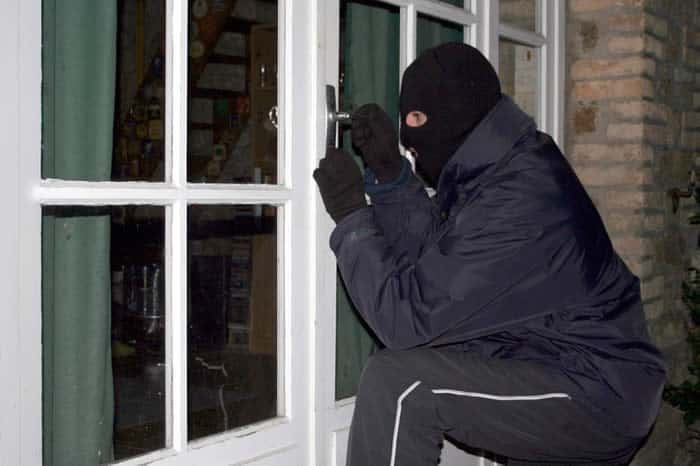 burglar brekaing into house